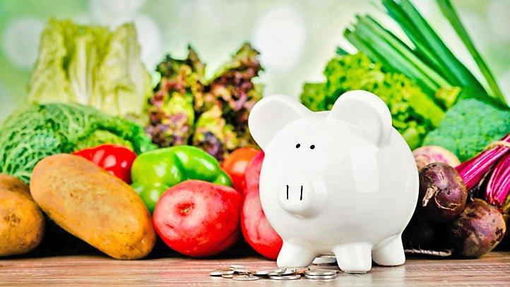 piggybank in front of vegetables